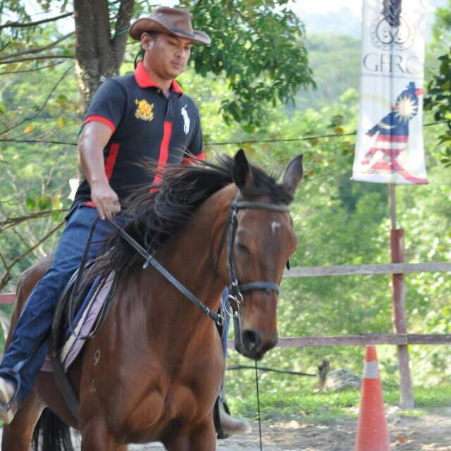 Mr. Sharil from Gombak Horse Riding Club on horse